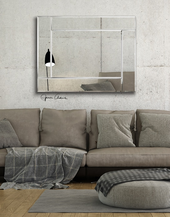 Pink sofa on the grey wall background. Minimalism interior
